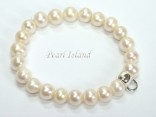 White Roundish Pearl Bracelet with Charm Carrier