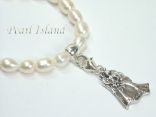 White Oval Pearl Bracelet with Dancing Bride & Groom Charm